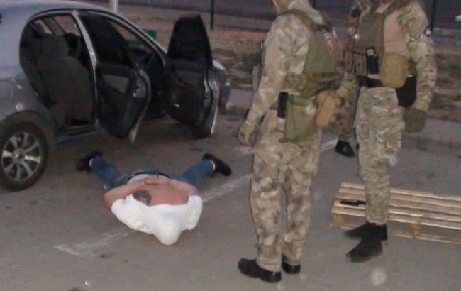 Фото - задержание злоумышленника. Источник : ssu.gov.ua